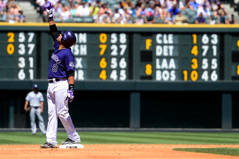 . Colorado Rockies catcher Yorvit Torrealba (8) points up after hitting a double in the during the second inning in Denver. The Colorado Rockies hosted the San Diego Padres at Coors Field on Sunday, June 9, 2013. (Photo by AAron Ontiveroz/The Denver Post)