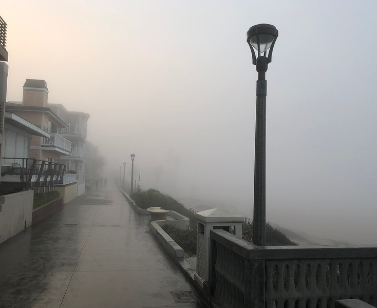 A foggy morning in Manhattan Beach, with the Pier hidden from view