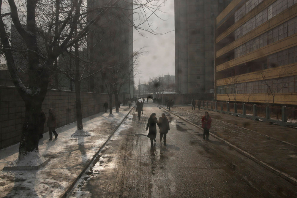 . North Korean commuters walk along a street in Pyongyang, North Korea on Tuesday, Feb. 26, 2008.  (AP Photo/David Guttenfelder)