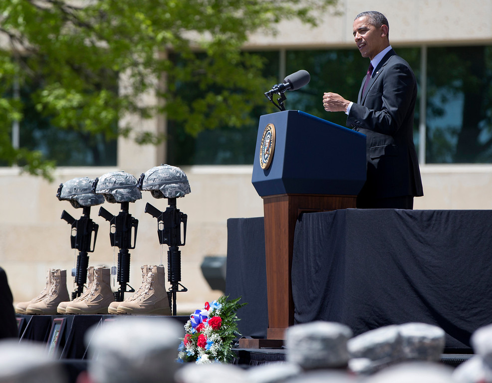 . President Barack Obama speaks during a memorial ceremony, Wednesday, April 9, 2014, at Fort Hood, Texas, for those killed there in a shooting last week. (AP Photo/Carolyn Kaster)