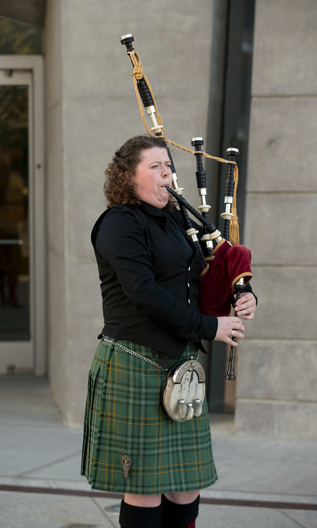. Piper Claire Raftery plays at a memorial Mass for the six people killed Tuesday in a Berkeley apartment building balcony collapse, Wednesday, June 17, 2015, at the Cathedral of Christ the Light in Oakland, Calif. (D. Ross Cameron/Bay Area News Group)