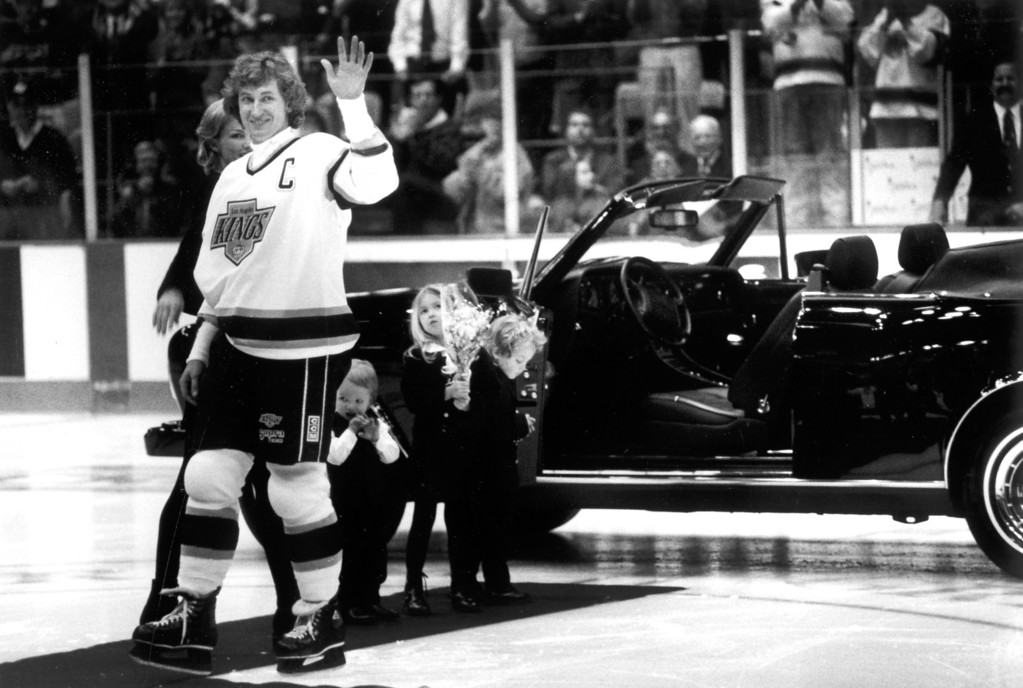 . Wayne Gretzky - with wife Janet and children Trevor, Paulina and Ty - acknowledges the Kings\' gift of a new Rolls-Royce on March 30, 1994.  L.A. Daily News file photo