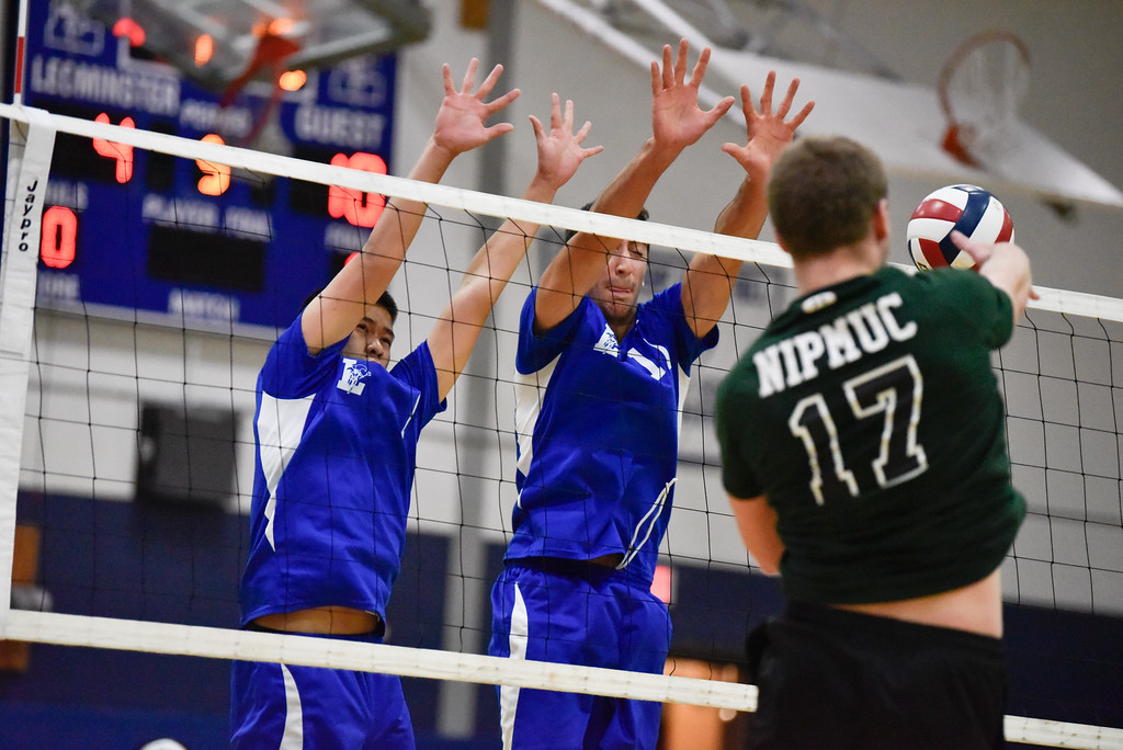 . Leominster junior Zachary Yang (left) and senior captain Kevin Barbara (center) attempts to block a spike from Nipmuc during a boys varsity volleyball tournament game against Nipmuc on Tuesday May 30, 2017 at Leominster High School.  SENTINEL & ENTERPRISE/JEFF PORTER