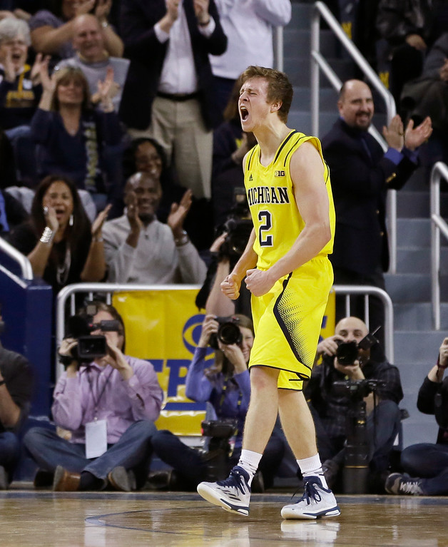 . Michigan guard Spike Albrecht reacts after a shot during the second half of an NCAA college basketball game against Ohio State, Sunday, Feb. 22, 2015 in Ann Arbor, Mich. Michigan defeated Ohio State 64-57. (AP Photo/Carlos Osorio)