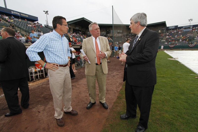 Kevin Bartram | Staff Gov. Dannel Malloy, left, talks to Rock Cats general manager Bill Dowling, center, and New Britain mayor Timothy O'Brien before the Eastern League All-Star game hosted by the Rock Cats on Wednesday at New Britain Stadium.