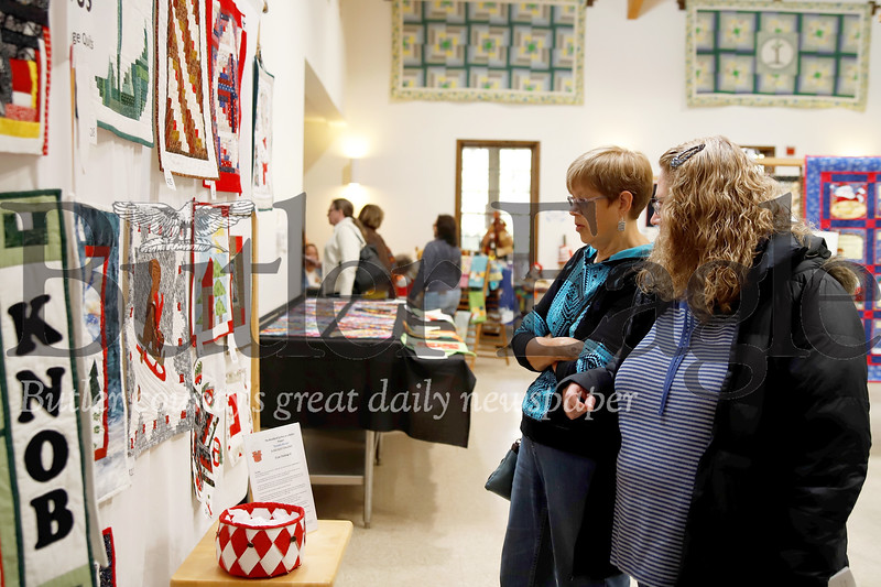 Quilt Show goers browse quilts on display Saturday. Seb Foltz/Butler Eagle