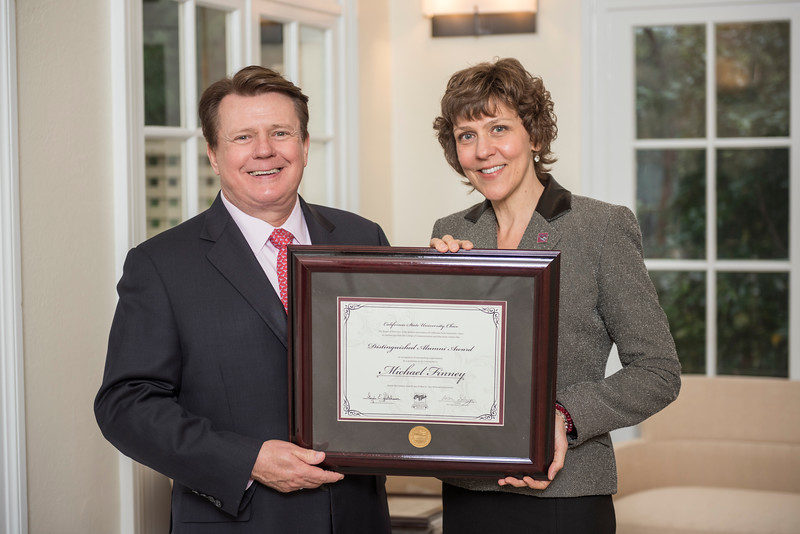 College of Communication and Education Distinguished Alumni Michael Finney (BA, Information and Communication Studies, 1978) (left) receives recognition by Angela Trethewey (Dean, CME) (right) on Friday, March 24, 2017 in Chico, Calif. (Jason Halley/University Photographer)