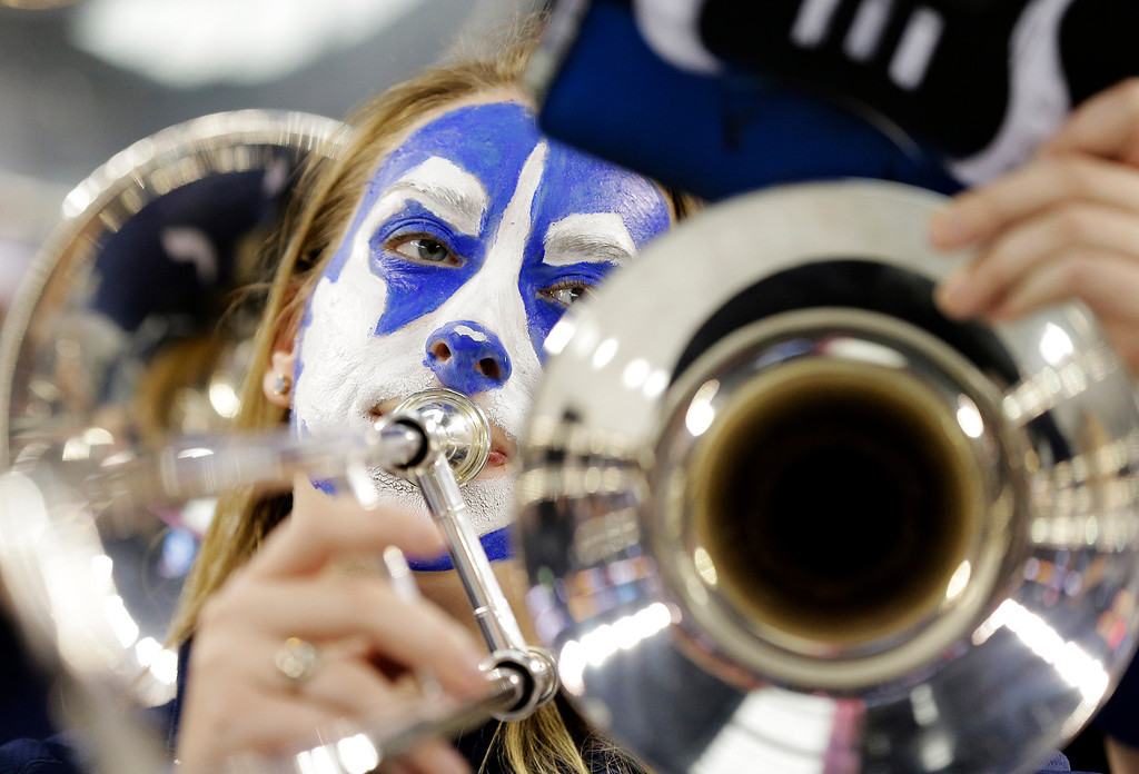 . CORRECTS LOCATION TO ARLINGTON, INSTEAD OF DALLAS - The Connecticut band plays before Connecticut\'s NCAA Final Four tournament college basketball semifinal game against Florida on Saturday, April 5, 2014, in Arlington, Texas. (AP Photo/Eric Gay)