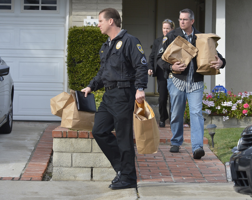 . LA PALMA, CALIF. -- Investigators leave the home of the mother of alleged triple-murderer  Christopher Dorner in La Palma, California on February 8, 2013.