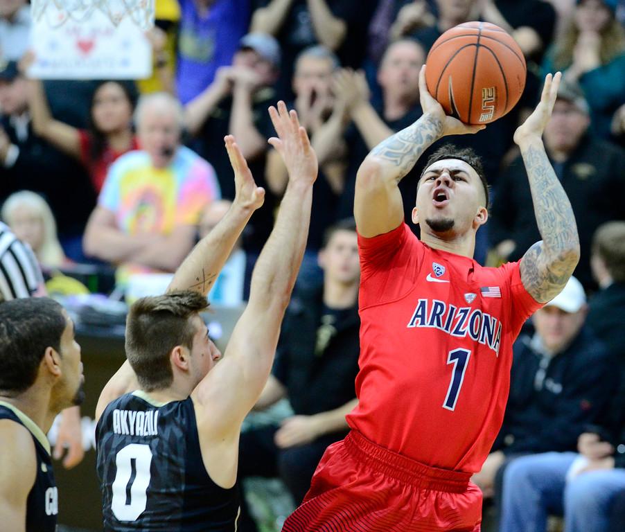 . Arizona guard Gabe York shoots over Colorado\'s Thomas Akyaili during the first half of an NCAA college basketball game Wednesday, Feb. 24, 2016, in Boulder, Coio. (AP Photo/Cliff Grassmick)