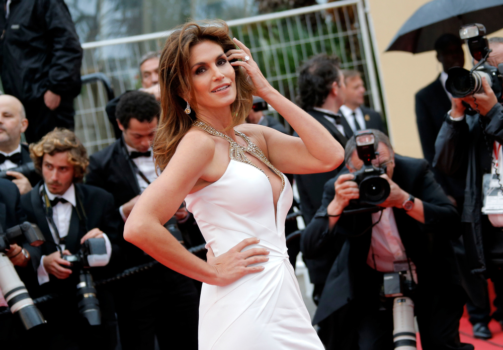 . Model Cindy Crawford arrives for the opening ceremony and the screening of The Great Gatsby at the 66th international film festival, in Cannes, southern France, Wednesday, May 15, 2013. (AP Photo/Francois Mori)