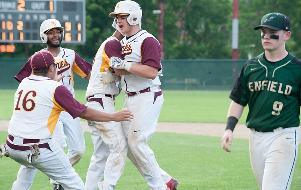 05/30/18 Wesley Bunnell | Staff New Britain baseball defeated Enfield 4-3 with a walk off bases loaded single in the bottom of the 7th in a first round CIAC Class LL tournament game. Michael Gajda (15), R, is swamped by teammates after hitting a bases loaded game winning single in the bottom of the 7th.