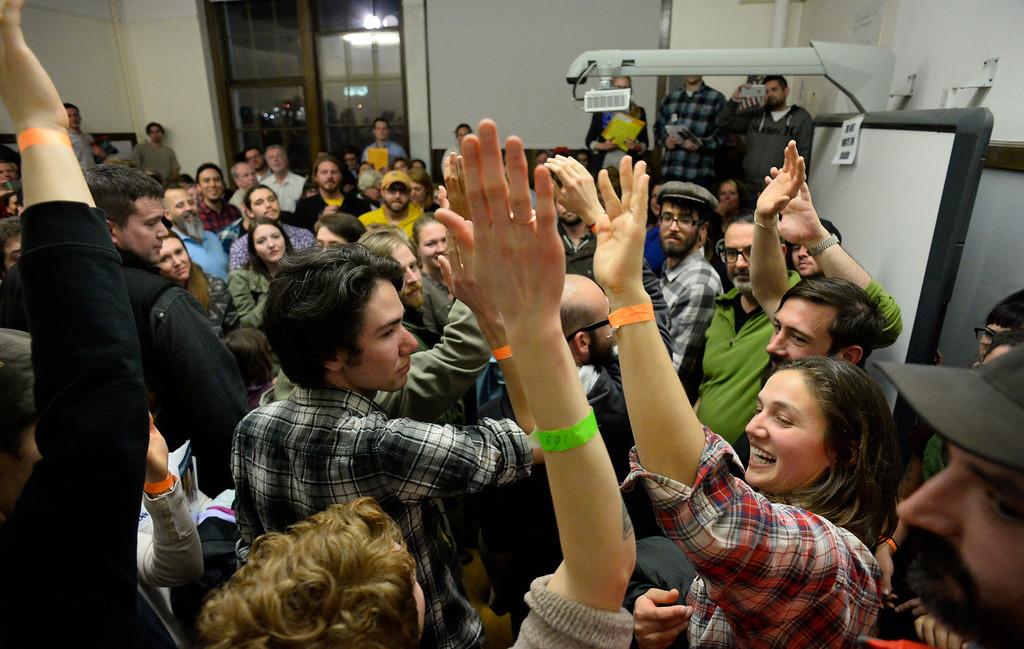 . People raised their hands and counted votes by high-fiving one another in a overflowing classroom as they vote for their precincts  during the caucus at East High school in Denver, Colorado on March 1, 2016. 18 precincts were represented at East High School and thousands of people turned out for the caucus. Organizers had anticipated about 20% of people from their precincts would turn out but many more actually came. (Photo by Helen H. Richardson/The Denver Post)