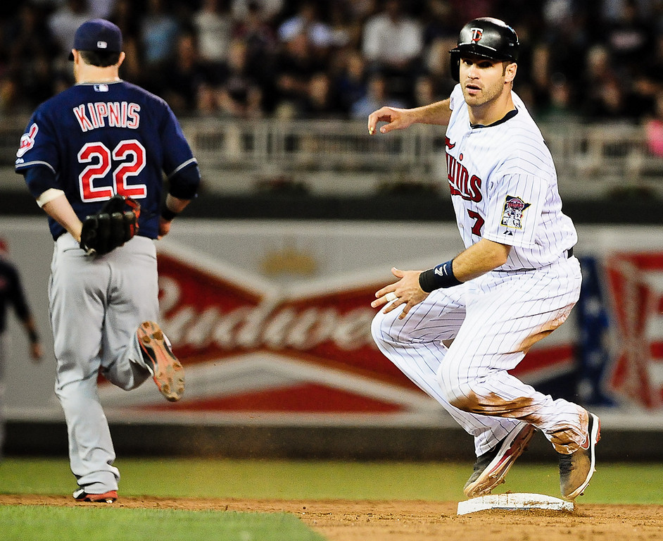 . Minnesota Twins catcher Joe Mauer pulls up at second in time to see Morneau ground out to second in the 6th inning. (Pioneer Press: Ben Garvin)