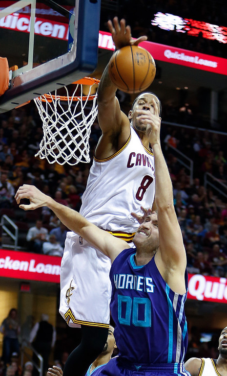 . Cleveland Cavaliers\' Channing Frye (8) blocks a shot by Charlotte Hornets forward Spencer Hawes (00) during the second half of an NBA basketball game Sunday, Nov. 13, 2016, in Cleveland. The Cavaliers won 100-93. (AP Photo/Ron Schwane)