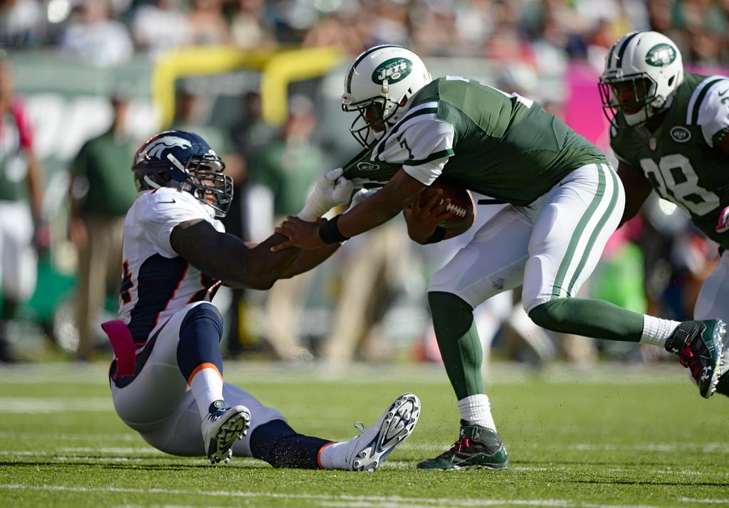 . Denver Broncos defensive end DeMarcus Ware (94) sacks New York Jets quarterback Geno Smith (7) during the third quarter  October 12, 2014 at Metlife Stadium. (Photo by John Leyba/The Denver Post)