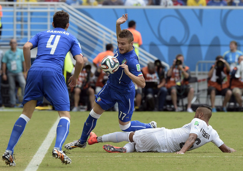 . Uruguay\'s midfielder Alvaro Pereira (R) tackles Italy\'s forward Ciro Immobile during a Group D football match between Italy and Uruguay at the Dunas Arena in Natal during the 2014 FIFA World Cup on June 24, 2014.   DANIEL GARCIA/AFP/Getty Images