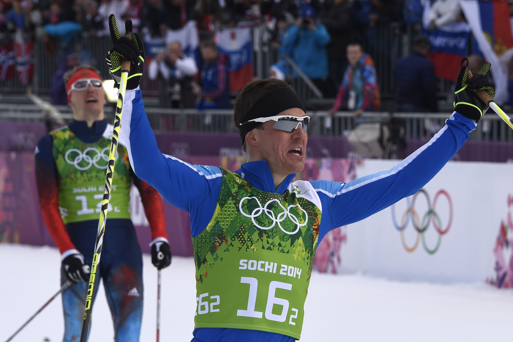 . Finland\'s Sami Jauhojaervi (R) crosses the finis line ahead of Russia\'s Nikita Kriukov  in the Men\'s Cross-Country Skiing Team Sprint Classic Final at the Laura Cross-Country Ski and Biathlon Center during the Sochi Winter Olympics on February 19, 2014 in Rosa Khutor near Sochi. (ODD ANDERSEN/AFP/Getty Images)