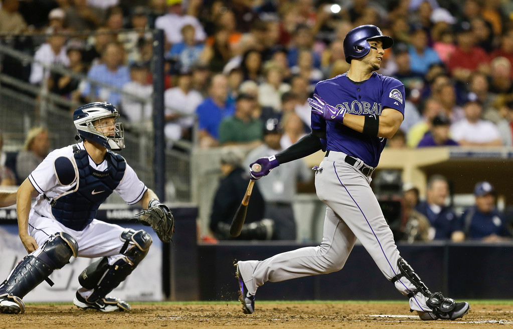 . Colorado Rockies\' Carlos Gonzalez lines a base hit to center against the San Diego Padres during the fifth inning of a baseball game in San Diego, Wednesday, July 10, 2013. It was his first hit since returning to the lineup. (AP Photo/Lenny Ignelzi)