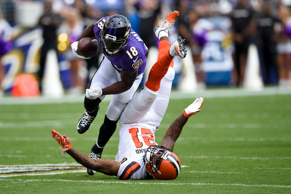 . Baltimore Ravens wide receiver Jeremy Maclin (18) upends Cleveland Browns cornerback Jamar Taylor (21) during the first half of an NFL football game in Baltimore, Sunday, Sept. 17, 2017. (AP Photo/Nick Wass)
