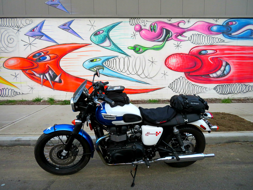 kenny scharf mural in the brox on Krinos food with triumph bonneville