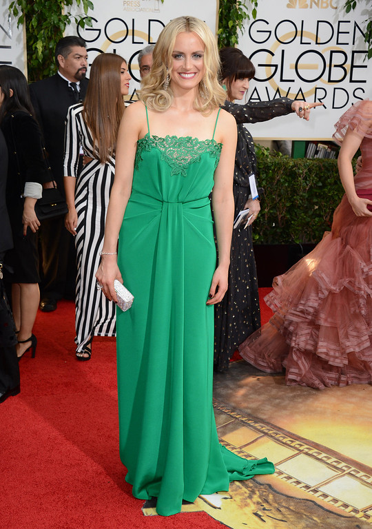 . Taylor Schilling arrives at the 71st annual Golden Globe Awards at the Beverly Hilton Hotel on Sunday, Jan. 12, 2014, in Beverly Hills, Calif. (Photo by Jordan Strauss/Invision/AP)