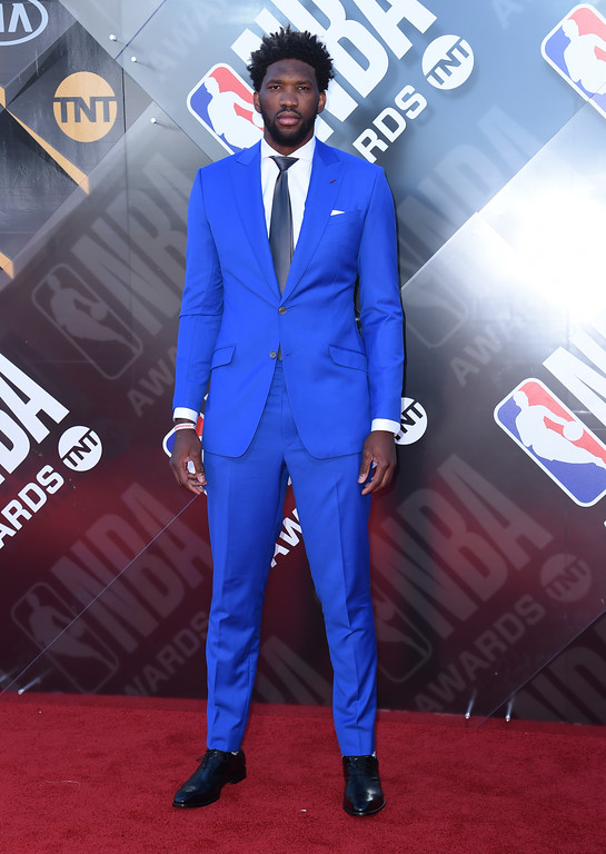 . NBA player Joel Embiid, of the Philadelphia 76ers, arrives at the NBA Awards on Monday, June 25, 2018, at the Barker Hangar in Santa Monica, Calif. (Photo by Richard Shotwell/Invision/AP)