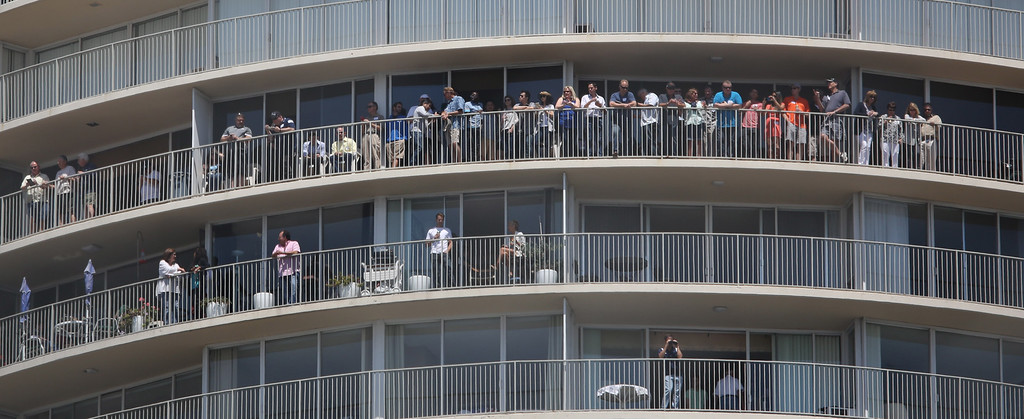 . Fans on the rails at the International Tower watch the 41st Toyota Grand Prix of Long Beach, Sunday April 19th, 2015, 2015.  Chuck Bennett/Staff Photographer.