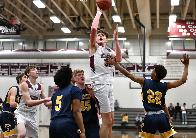 1/17/2020 Mike Orazzi   Staff Bristol Central's Donovan Clingan (32) under the hoop against Simsbury at Bristol Central Friday night.