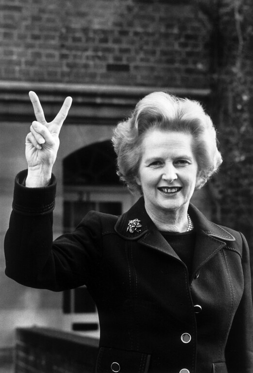 . November 1976:  Conservative party leader Margaret Thatcher makes a \'victory\' sign outside her home in Chelsea, London.  (Photo by John Minihan/Evening Standard/Getty Images)