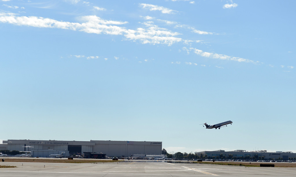 . A plane takes off at the Long Beach Airport August 6, 2013. (Thomas R. Cordova/Staff Photographer)