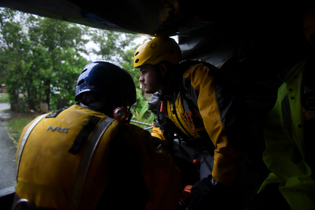 . Joshua Alicea, right, rescue staff member from the Municipal Emergency Management Agency toured the streets of the Matelnillo community searching for citizens in distress during the passage of Hurricane Irma through the northeastern part of the island in Fajardo, Puerto Rico, Wednesday, Sept. 6, 2017. The US territory was first to declare a state of emergency las Monday, as the National Hurricane Center forecast that the storm would strike the Island Wednesday. (AP Photo/Carlos Giusti)