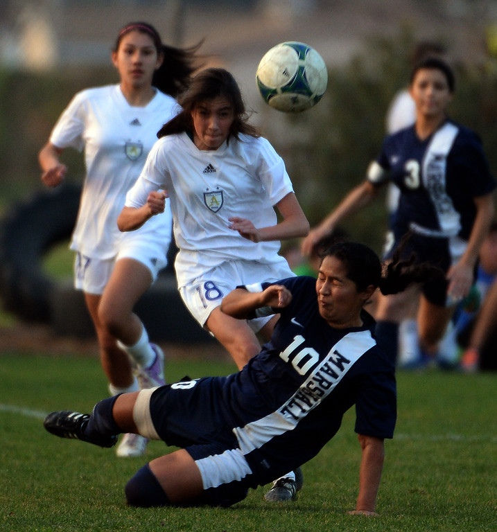 . Marshall\'s Roxana Hernandez (10) fights for the ball with Bishop Amat\'s Ashley Rushlow (18) in the first half of a prep soccer match at Bishop Amat High School in La Puente, Calif., on Thursday, Jan. 9, 2014.Amat won 3-0. (Keith Birmingham Pasadena Star-News)