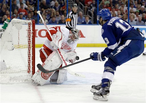. Detroit Red Wings goalie Petr Mrazek (34), of the Czech Republic, makes a glove save on a shot by Tampa Bay Lightning center Cedric Paquette (13) during the second period of Game 1 of an NHL hockey first-round playoff series Thursday, April 16, 2015, in Tampa, Fla. (AP Photo/Chris O\'Meara)