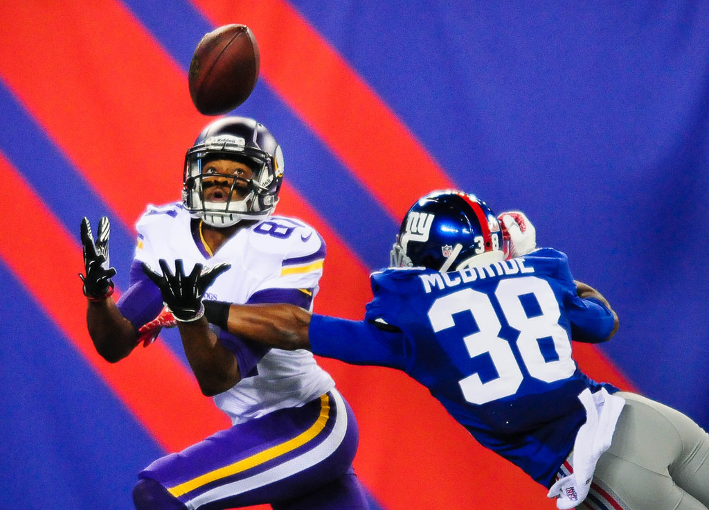 . Vikings wide receiver Jerome Simpson dropped a potential touchdown pass while under pressure from Giants cornerback Trumaine McBride in the third quarter.   (Pioneer Press: Ben Garvin)