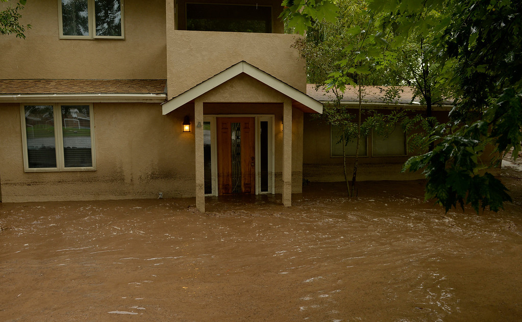 . BOULDER, CO - SEPTEMBER 12: Flood waters surround a home in north Boulder, September 12, 2013. Massive flash flooding is on going along the Front Range of Colorado. (Photo By RJ Sangosti/The Denver Post)
