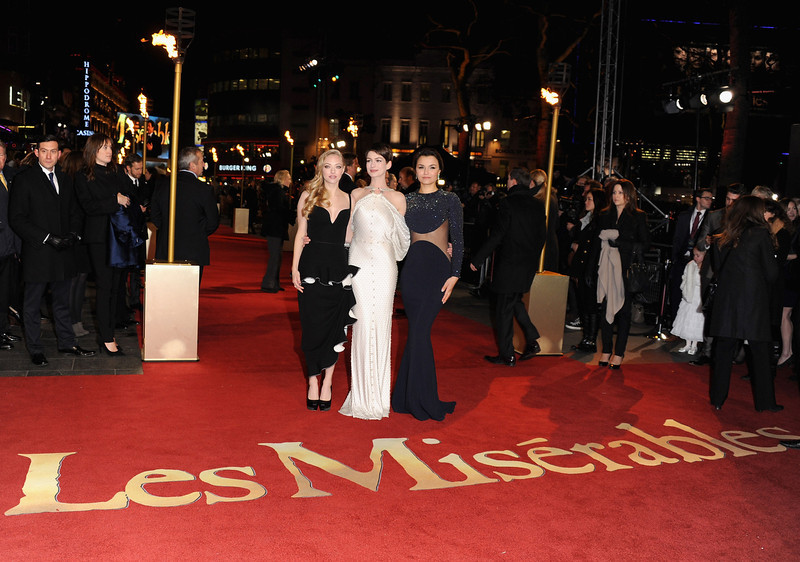 """. Actresses Amanda Seyfriend, Anne Hathaway and Samantha Barks attend the \""""Les Miserables\"""" World Premiere at the Odeon Leicester Square on December 5, 2012 in London, England.  (Photo by Stuart Wilson/Getty Images)"""