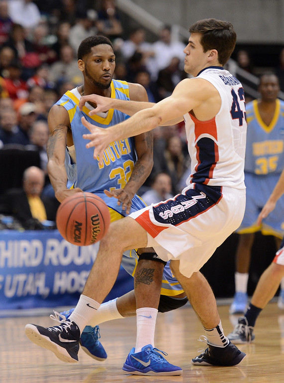 . SALT LAKE CITY, UT - MARCH 21:  Brandon Moore #32 of the Southern University Jaguars passes the ball against Drew Barham #43 of the Gonzaga Bulldogs in the first half during the second round of the 2013 NCAA Men\'s Basketball Tournament at EnergySolutions Arena on March 21, 2013 in Salt Lake City, Utah.  (Photo by Harry How/Getty Images)