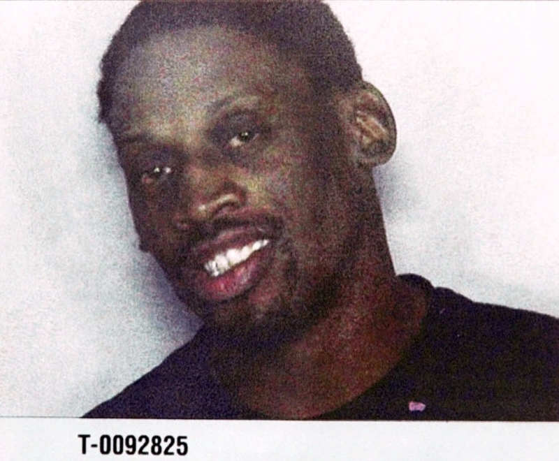 . Former basketball star Dennis Rodman is seen here in a police mugshot after he was arrested with actress Carmen Electra Friday, Nov. 5, 1999, by Miami Beach Police after they allegedly fought in a hotel. The couple was release on $2,500 bond after being booked in the Miami-Dade County Jail. (AP Photo)