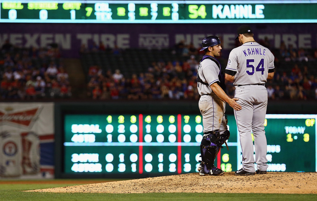 . ARLINGTON, TX - MAY 08:  Michael McKenry #8 of the Colorado Rockies talks with Tommy Kahnle #54 of the Colorado Rockies on the mound as the Rockies take on the Texas Rangers in the bottom of the seventh inning at Globe Life Park in Arlington on May 8, 2014 in Arlington, Texas.  (Photo by Tom Pennington/Getty Images)