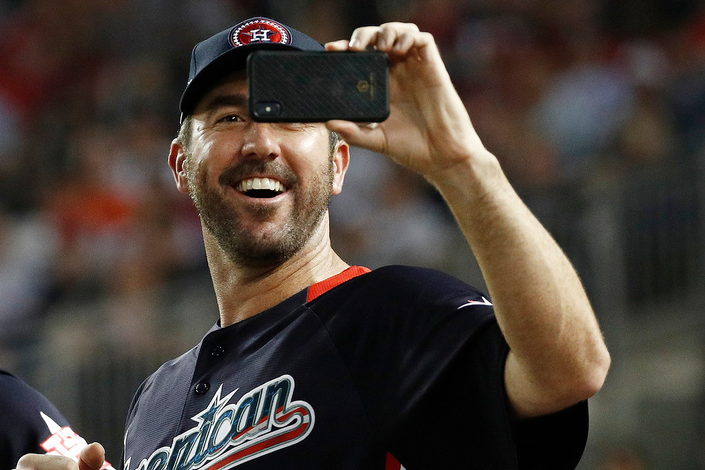 . American League, Boston Red Sox pitcher Justin Verlander (35) shoots pictures during the MLB Home Run Derby, at Nationals Park, Monday, July 16, 2018 in Washington. The 89th MLB baseball All-Star Game will be played Tuesday. (AP Photo/Patrick Semansky)