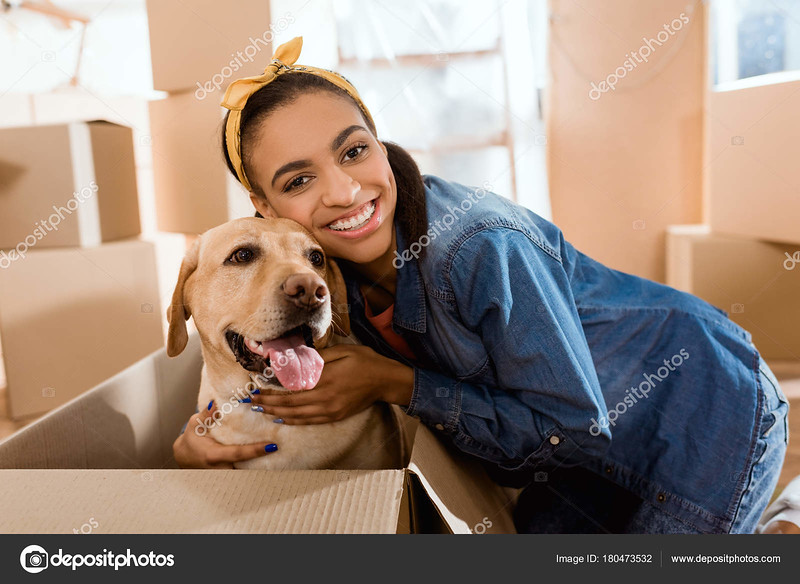 depositphotos_180473532-stock-photo-smiling-african-american-woman-labrador.jpg