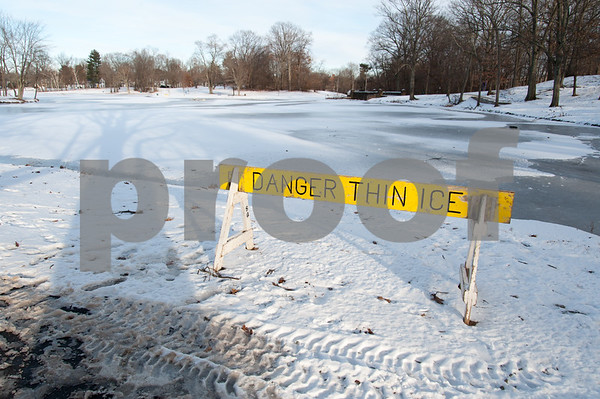12/29/17 Wesley Bunnell | Staff A danger thin ice sign at Stanley Quarter park on Friday December 29 with temperatures in the teens.