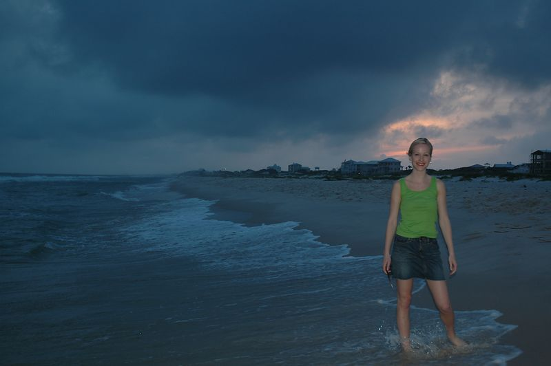 Kate playing in the waves as the sun sets.