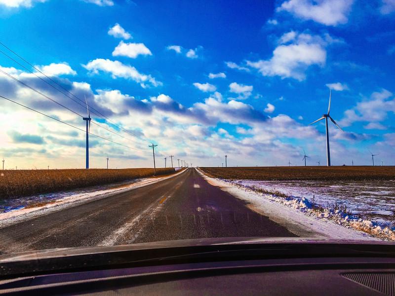 Rural road through wind farm.