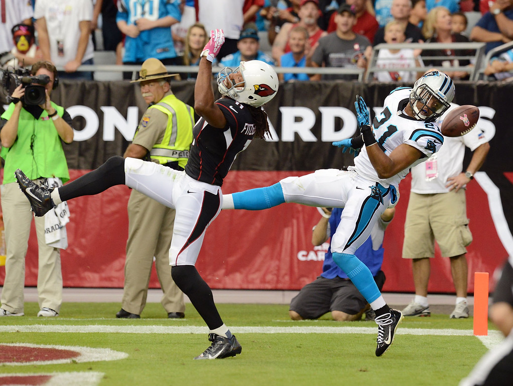 . Larry Fitzgerald #11 of the Arizona Cardinals and Mike Mitchell #21 of the Carolina Panthers cannot come up with the pass in the back of the endzone at University of Phoenix Stadium on October 6, 2013 in Glendale, Arizona.  (Photo by Norm Hall/Getty Images)