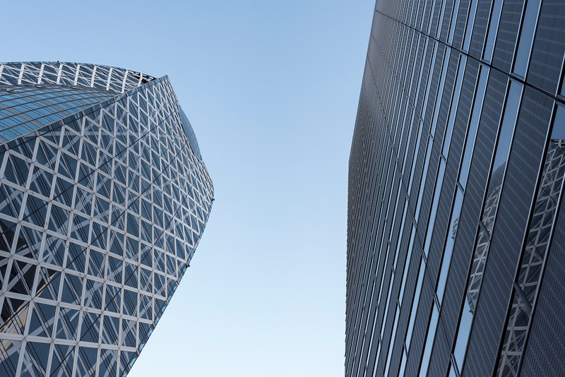 Low-angle view of Mode Gakuen Cocoon Tower and Shinjuku L Tower, Tokyo, Japan