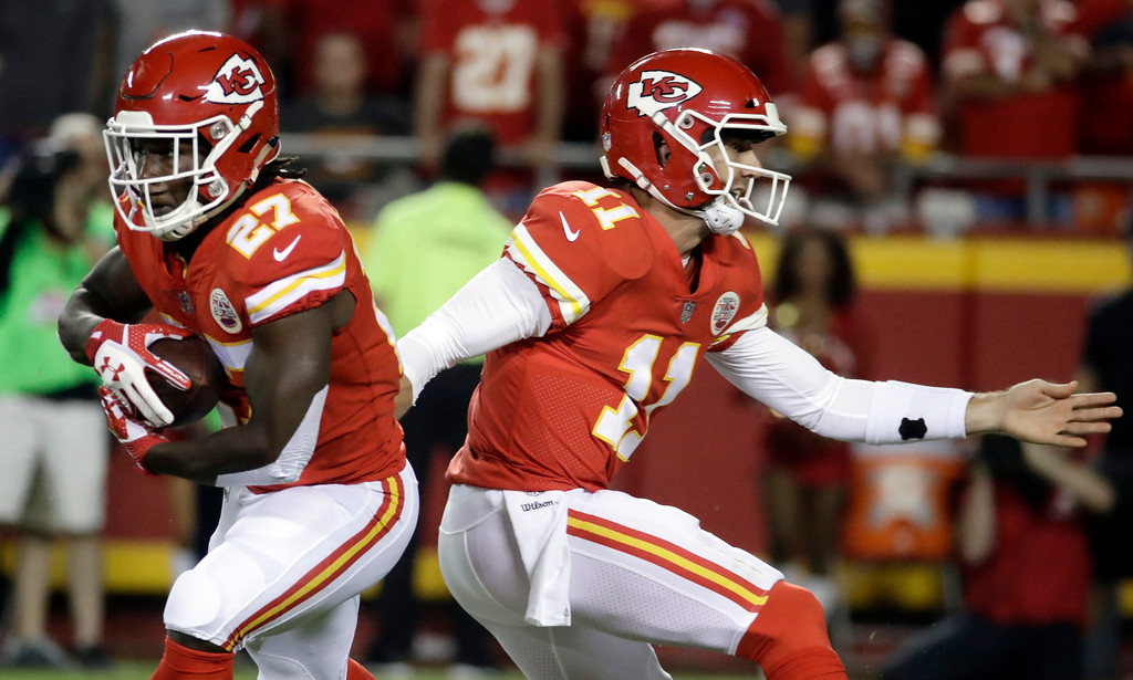 . Kansas City Chiefs running back Kareem Hunt (27) takes a handoff from quarterback Alex Smith (11) during the first half of an NFL football game against the Washington Redskins in Kansas City, Mo., Monday, Oct. 2, 2017. (AP Photo/Charlie Riedel)