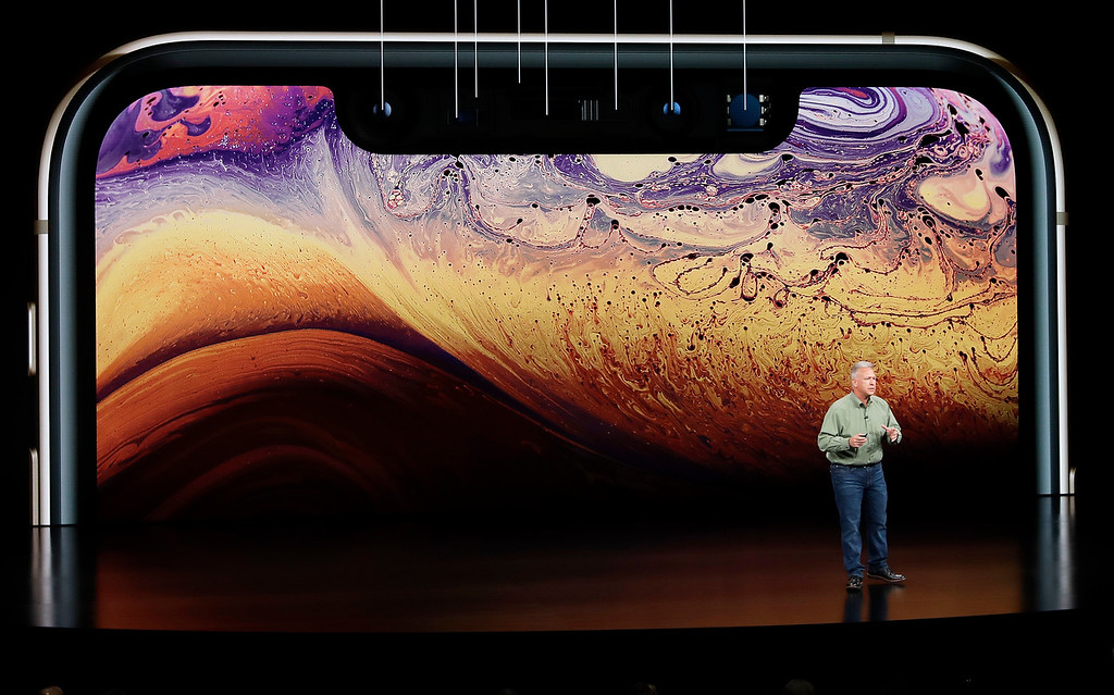 . Phil Schiller, Apple\'s senior vice president of worldwide marketing, speaks about the Apple iPhone XS at the Steve Jobs Theater during an event to announce new Apple products Wednesday, Sept. 12, 2018, in Cupertino, Calif. (AP Photo/Marcio Jose Sanchez)