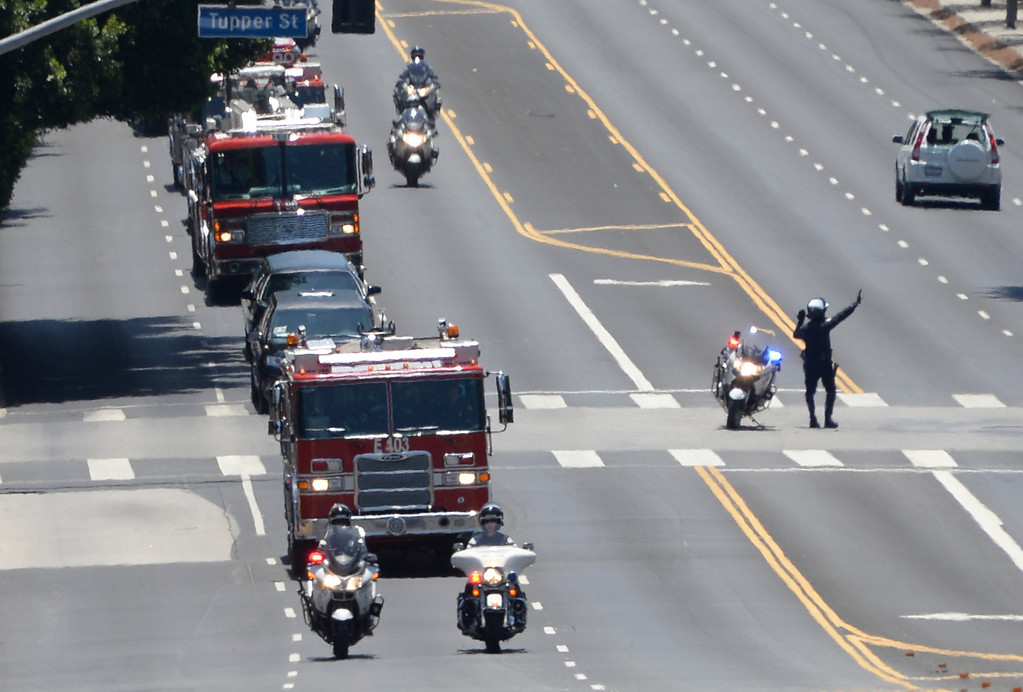 . June 17, 2014. Northridge. CA. LAPD escort  L.A. city firefighters procession with LAFD helicopter pilot Brian Lee through Northridge on Tuesday. Lee was killed on June 9th, along with an 8-year-old child, after his private plane crashed at El Mirage Dry Lake.  Photo by Gene Blevins/L.A. Daily News